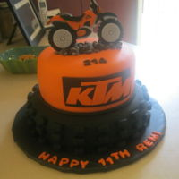Dirt Bike Cake Dirt bike tire made with a 10x3 chocolate cake covered with black fondant. KTM logo and dirt bike topper made from patterns found on the...