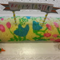 Easter Cake Roll This is a inlay sponge cake. The flower design is the cake batter with different colors and baked into the cake. Filled with white...