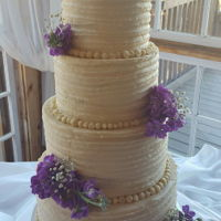 First Wedding Cake This was my first ever wedding cake, for a friend of a friend. 4 tier, WASC cake with raspberry filling and SMBC. This was my first time...