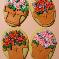 Flower Pot Sugar Cookies Sugar Cookies decorated like flower pots with Royal icing.