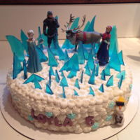"Frozen Cake   10 inch chocolate cake. Candy ""ice"" shards ."
