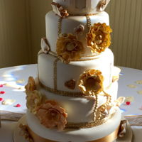 Gold-Ivory Wedding Cake This is the cake I made for my son and daughter-in-law's wedding. I was very happy with the way it turned out. The cake was white...