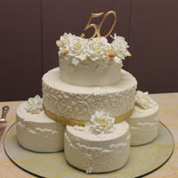 "Golden Anniversary Lace And Roses Inspired by the couple's original wedding cake..4 8"" cakes topped with 12"" and 10"" cakes."