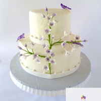 Gumpaste Flower Spray On Buttercream Cake Buttercream iced wedding cake with gumpaste flower spray and gumpaste butterflies