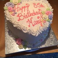 Happy Birthday Mary Simple: Vanilla cake w/vanilla buttercream with floral decorations made out of royal icing