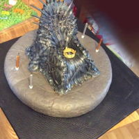 Iron Throne Chocolate sponge covered with fondant swords,,,sugarpaste crown on seat