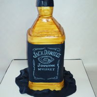 Jack Daniel's Cake The cake itself is a Jack Daniel's cake - ingredients include the whiskey, butterscotch, and walnuts. I carved the cake and covered it...