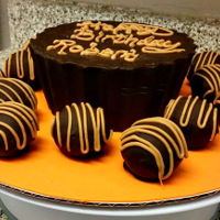 Jumbo Peanut Buttercup! Jumbo Peanut butter cup cake for a Resse's lover with some chocolate peanut butter cake balls