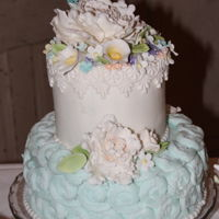 "Kc Flowers And Lace 6"" and 10"" Orange Crème wedding cake covered in buttercream with orange custard filling. Gum paste flowers &..."