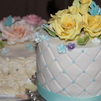"Kc Flowers And Lace Ii 8"" Lemon Crème covered in buttercream filled with Lemon Custard with gum paste roses & butterfly with fabric ribbon."