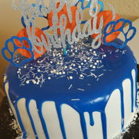 Kentucky Drip Cake Royal Blue white chocolate drip cake. Cake toppers cut out from Cricut Explore.