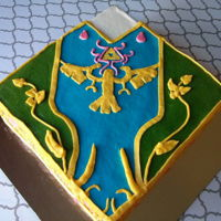 Legend Of Zelda Cake I loved this design! This was for my daughter's birthday, she is a huge Zelda fan :D Here's a video showing how I made it: