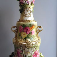 Limoges Wedding Cake   Three tall tiers to portray Vintage French Limoges Porcelain.Sculpted, Hand Painted, porcelain, Gold handles, Sugar flowers in top vase.