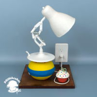 Luxo Jr Pixar lamp was created out of fondant and the ball he is playing on was created out of cake and then covered in fondant. I entered this...