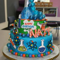 Mad Scientist Cake Buttercream with chocolate transfers, candy clay balls, gelatin bubbles, RKT flask and test tube covered in candy clay.