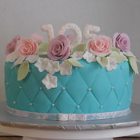 Pastel Flowers Pink and purple roses on a Teal cake. I feel privileged to be asked to make a 105th birthday cake. I am so happy with how it has turned out...