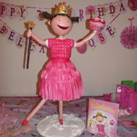 Pinkalicious Sculpted Pinkalicious cake standing 3 feet tall.