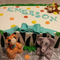 Safari Jungle Baby Shower Vanilla cream cake with butter cream and fondant animals and zebra pattern.