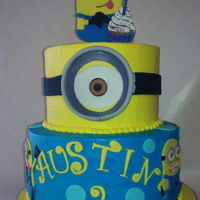Simple Minion Cake This is buttercream with layered fondant accent pieces. The cake was plain ole white with simple syrup and American buttercream filling and...