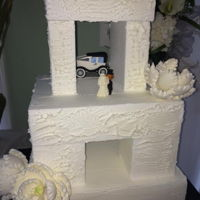 Stone Henge Version Totally white butter cream textured modern version of Stone Henge with white gumpaste peonies & our pride & joy get away sugar car...