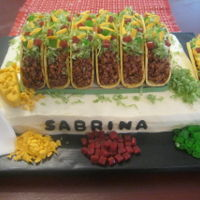 Taco Cake Can't take credit for the design. Taco shells made from gold fondant with some tinted brown granulated sugar pressed into it. Lettuce-...