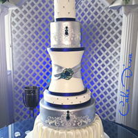 Wedding Cake The bride wanted something tall, large and odd shaped with hints of navy and silver plus bling!