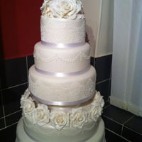 Wedding Cake   Sugarpaste cake with hand made roses and lace