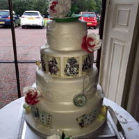 Wedding Cake   Alice in wonderland themed wedding cake. Sugar paste cup and saucer, sugar flowers and models