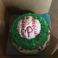 Baseball Smash Cake Round ball cake with white chocolate baseballs
