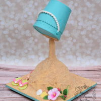 Beach Bucket  Cake was based upon one done by Cake Heart. Bucket was made from styrofoam and covered in 50/50 fondant and gum paste. Sand was made using...