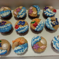 Beach Cupcakes Cupcakes iced in buttercream with cookie crumb sand and fondant or white chocolate decorations