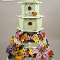 Birdhouse Garden This cake won in the Central Florida cake competition first prize and Best in Show. Featured in the June Cake Central Magazine issue. Hope...
