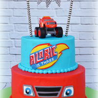 Blaze And The Monster Machines Butter cream cake with fondant embellishments. Toy on top
