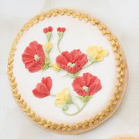 Brush Embroidery Poppy Cookies A spray of poppies and buttercup using brush embroidery