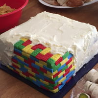 Buttercream Covered Legos Made fondant Legos over crumb coat, then used buttercream to give the impression that it covered a Lego cake.