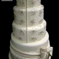 Buttons And Lace..   Fondant Finish with gumpaste details. Thanks for looking!Edna :)www.designmeacake.com