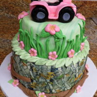 Camo Baby Shower Cake   Two tier fondant covered cake with fondant decorations and fondant topper.