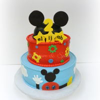 Clubhouse Mickey Birthday Buttercream iced tiers with fondant accents.