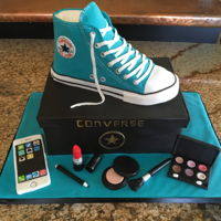Converse Shoe Cake Converse shoe is made of RKTMakeup and IPhone are fondant. Shoebox is cake