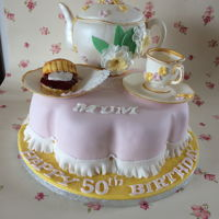 "Cream Tea W this was hand made life size tea pot cup and scone all made out of flower paste in a massive 16"" petal cake"