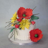 Daisies & Poppies Cake 5-28-2016 Lemon cake, Vanilla Swiss meringue buttercream, gumpaste flowers.