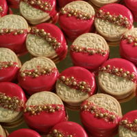 Decorated Oreos Golden Oreos dipped in chocolate and decorated for a high school graduation. Their colors are red and gold.