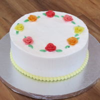 Easter Cake I made this for easter, it's lemon with lemon buttercream and the roses are made with Starburst candies. :)