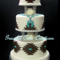 Elegant Navajo Wedding Cake Elegant Navajo Design Wedding Cake in white fondant accented with turquoise, brown and silver.