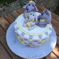 Elephant Themed Baby Shower Cake Vanilla cake with vanilla fudge frosting covered in fondant. Hand sculpted toppers made with gumpaste