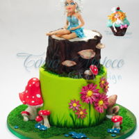 Enchanted Forest Enchanted forest , is a 2 tier cake fully decorated with SweetArt sugar paste .All decorations were modeled by hand.