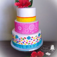 Fiesta Wedding Cake Brightly colored fiesta themed wedding cake. Handmade sugar hibiscus, custom tiles, colorful mosaic and bright pink sugar lace