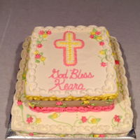 First Communion All buttercream decorations with vines and pale pink and yellow flowers.