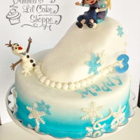 Frozen Cake Little Anna & Little Elsa in their famous scene playing in the snow.