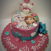Frozen Sisters A classic vanilla cake with buttercream icing. Featuring the sisters from Disney's Frozen, The client's duaghter liked Anan...
